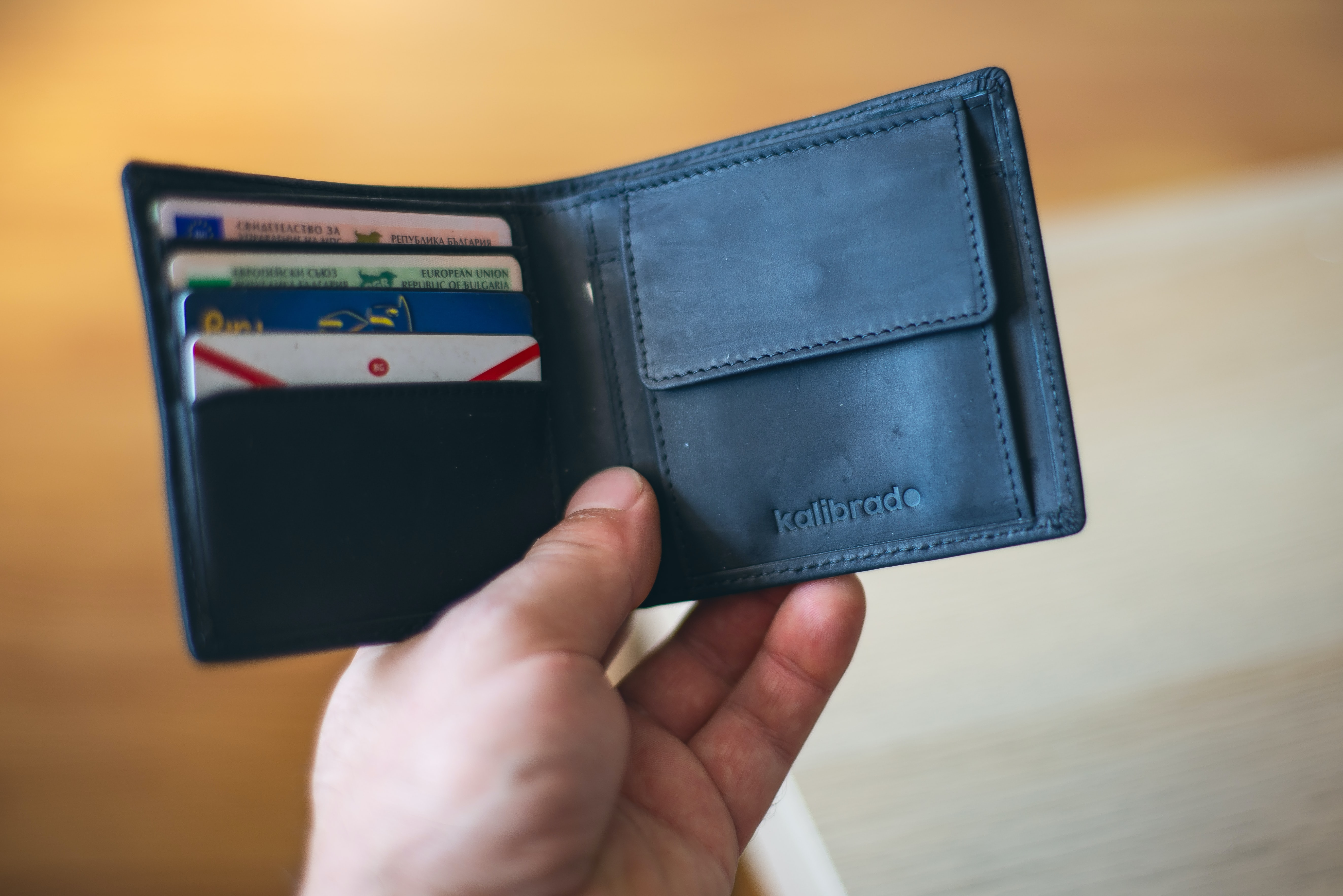 Person holding a wallet