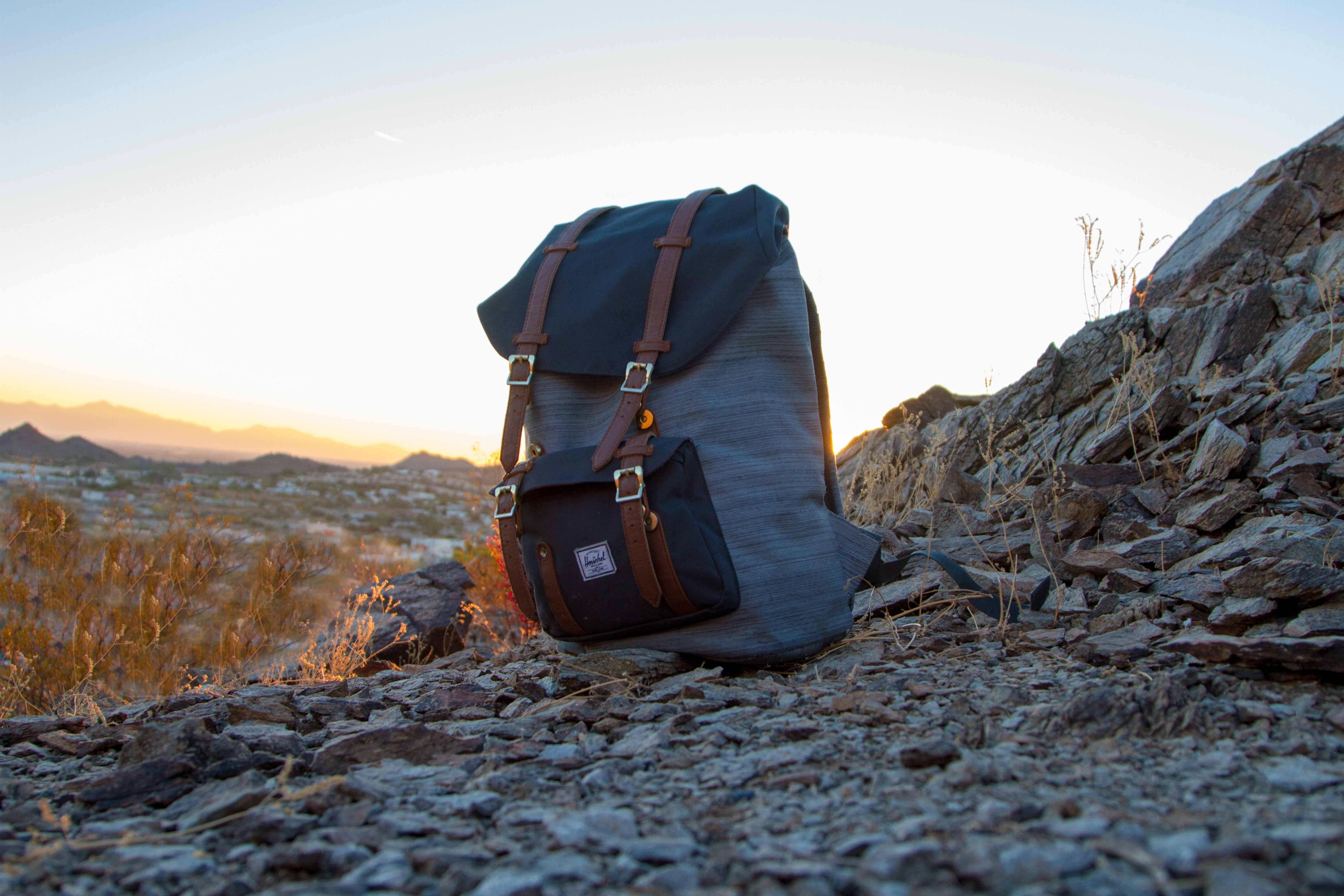 backpack sitting on a rocky hillside