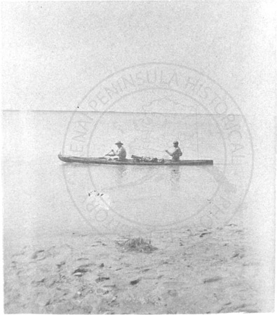 Two men in a bidarka canoe, Prince William Sound 1895-1903