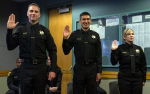 three correction officers taking an oath