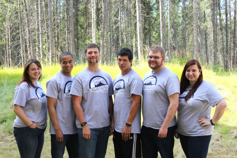 An outdoor picture of six student staff members.