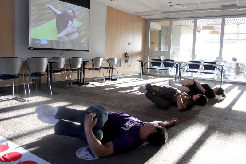 Multi-purpose room, showing students exercising on the large, open floor.